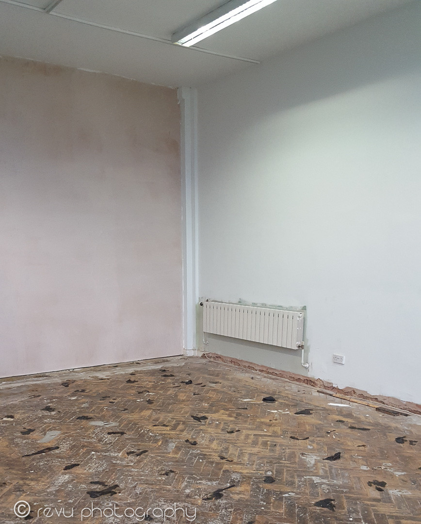 a lovely new plasered wall and the carpet tiles removed. unfortunately the parquet flooring was beyond rescuing.
