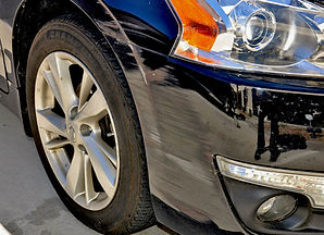 This black Nissan Altima has a scrape on its' front bumper that could have been avoided if it had an XPEL PPF Clear Bra.