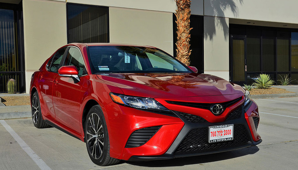 This is a cherry red Toyota Camry with #3M Crystaline Window Tint.