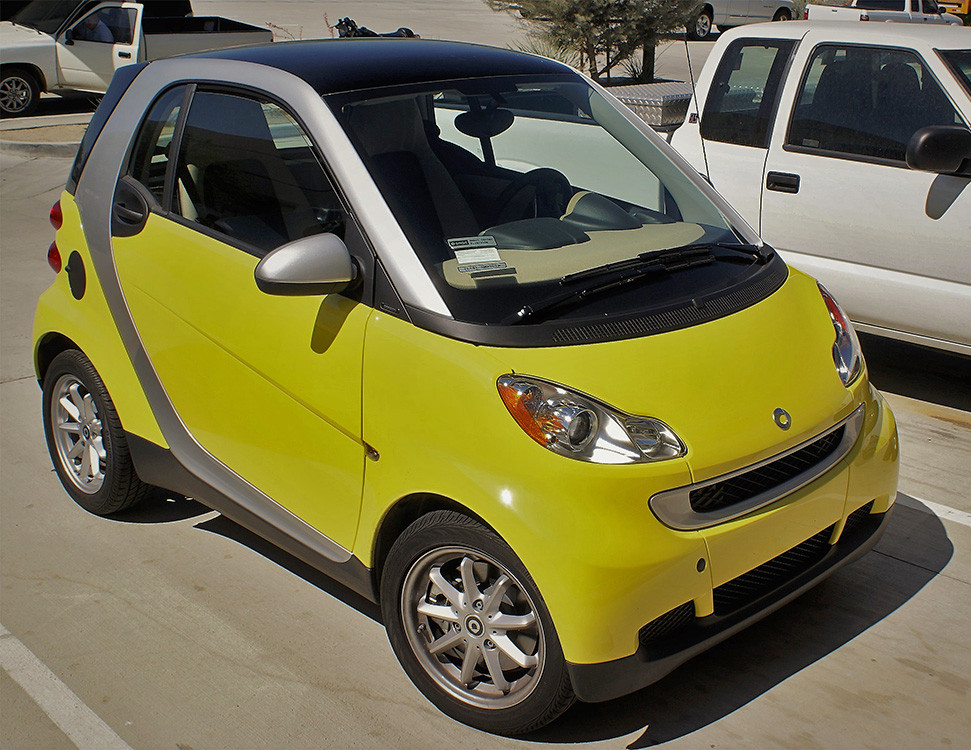This is a yellow Smart car with XPEL Paint Protection Film.