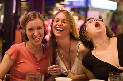 Group of Ladies Laughing at Trivia