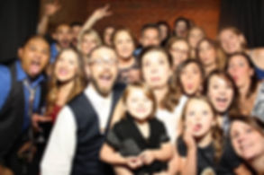 Group of people in a Photo Booth at a Wedding