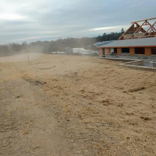 Spreading Straw for Erosion Control