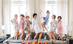 Bridesmaids dancing in their robes