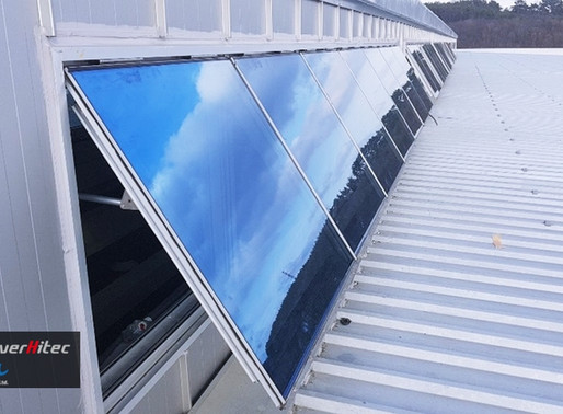 Attic Ventilation On The Roof Of Large Factory With Electric Window Openers
