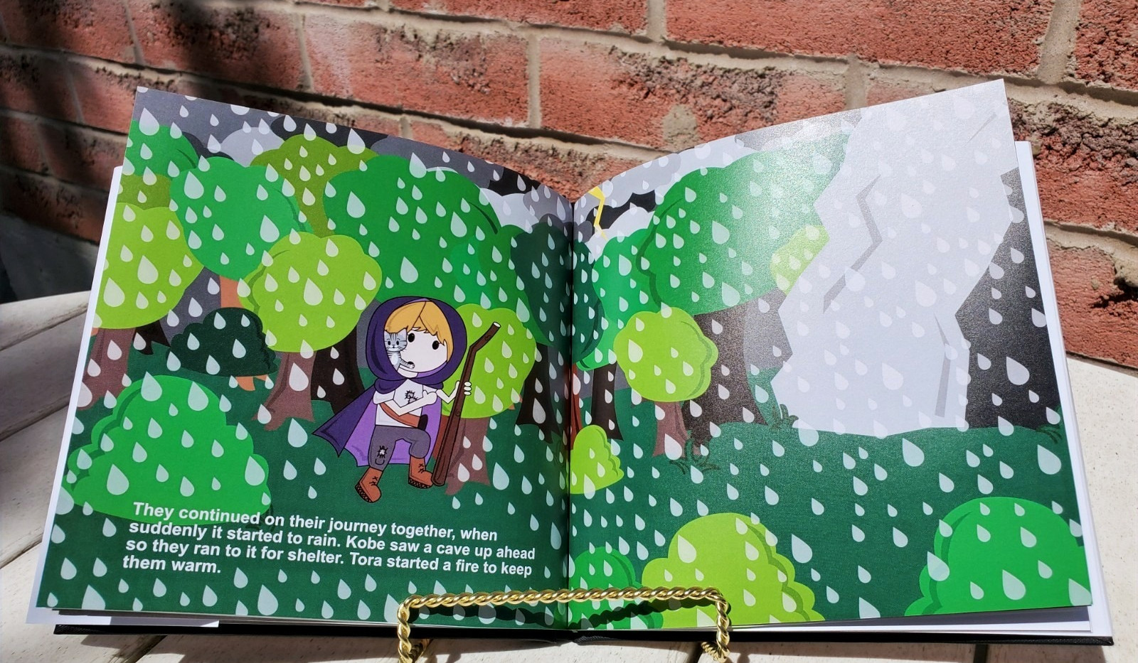 Image of the female version of the custom storybook with the woods in the background and a cave.