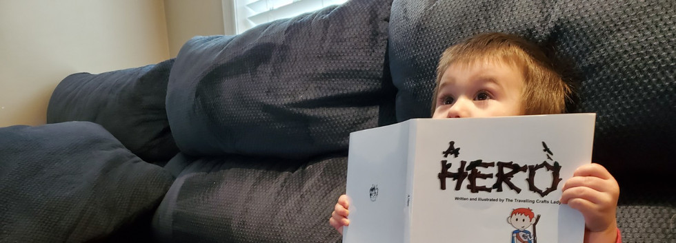 Little boy holding the custom storybook up to his face