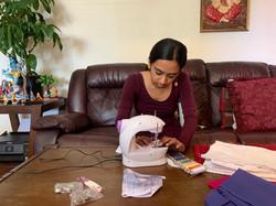 Divija stitching up masks
