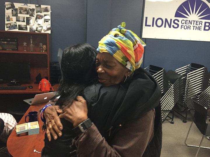 Warm hug between Donum Visi and Oakland staff