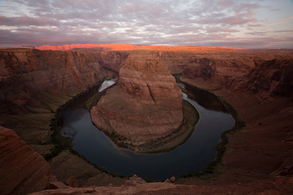 Unedited fine art landscape photography wall art of Horseshoe Bend at sunrise with a cloudy sky