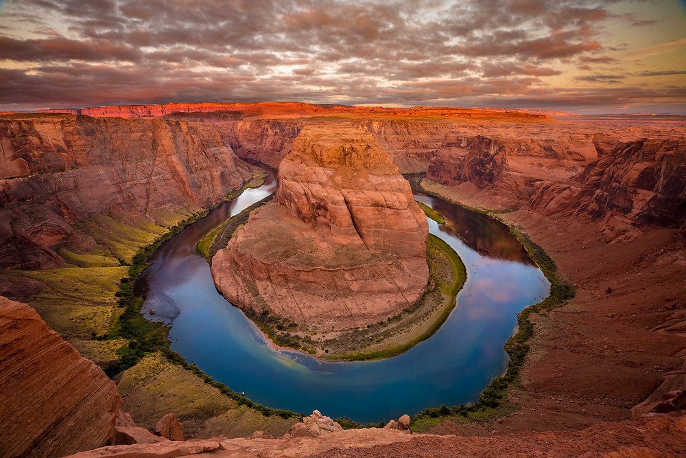 Fine art landscape photography wall art of Horseshoe Bend at sunrise with a cloudy sky