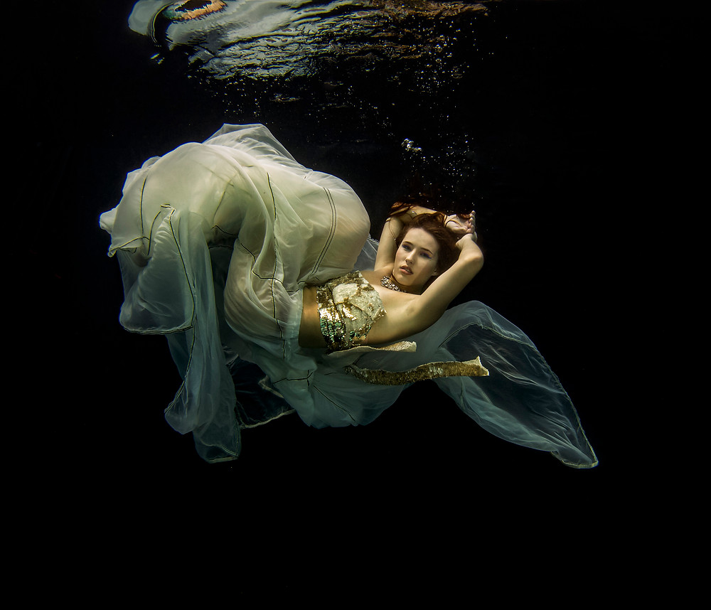 MAtt MCGee made an old parachute into a skirt for underwater fashion photography