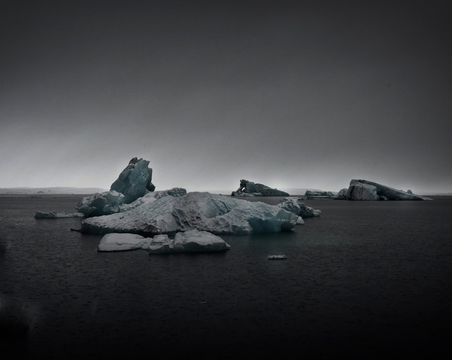 Moody icebergs in the glacier lagoon in Iceland by Matt McGee photographer