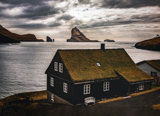 Grass roof house with a view of Tindholmur in the faroe Islands