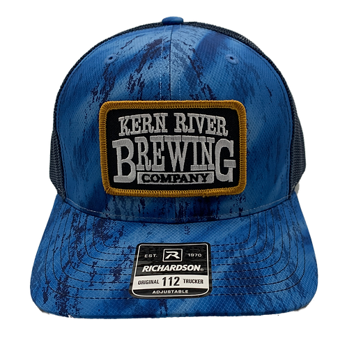 Blue design hat with patch