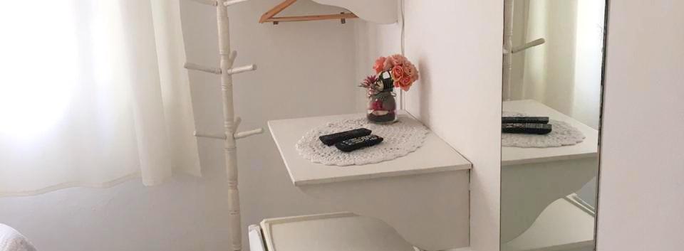 Suite com frigobar e TV a cabo