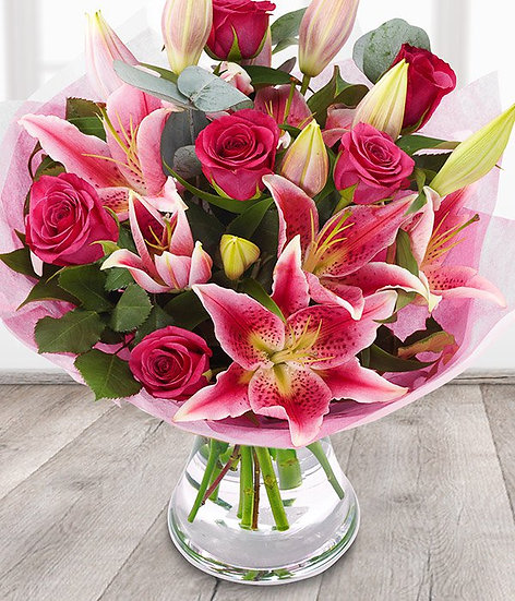 Pink open lily and rose bouquet