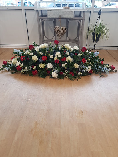 RED, WHITE AND SKY BLUE MIXED CASKET SPRAY