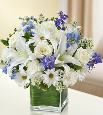 LILLY,ROSE AND BLUE DELPHINIUM TABLE DISPLAY