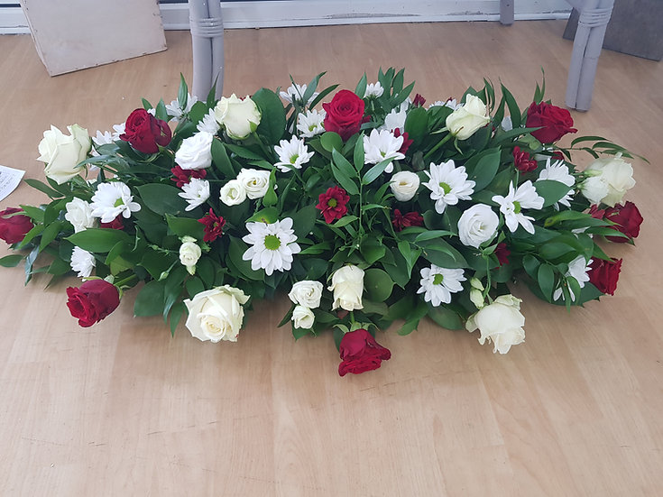 RED. CREAM AND WHITE ROSE, LIZZIE AND CHRYSANTH CASKET SPRAY