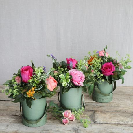Set of three Rose posies in milk churns