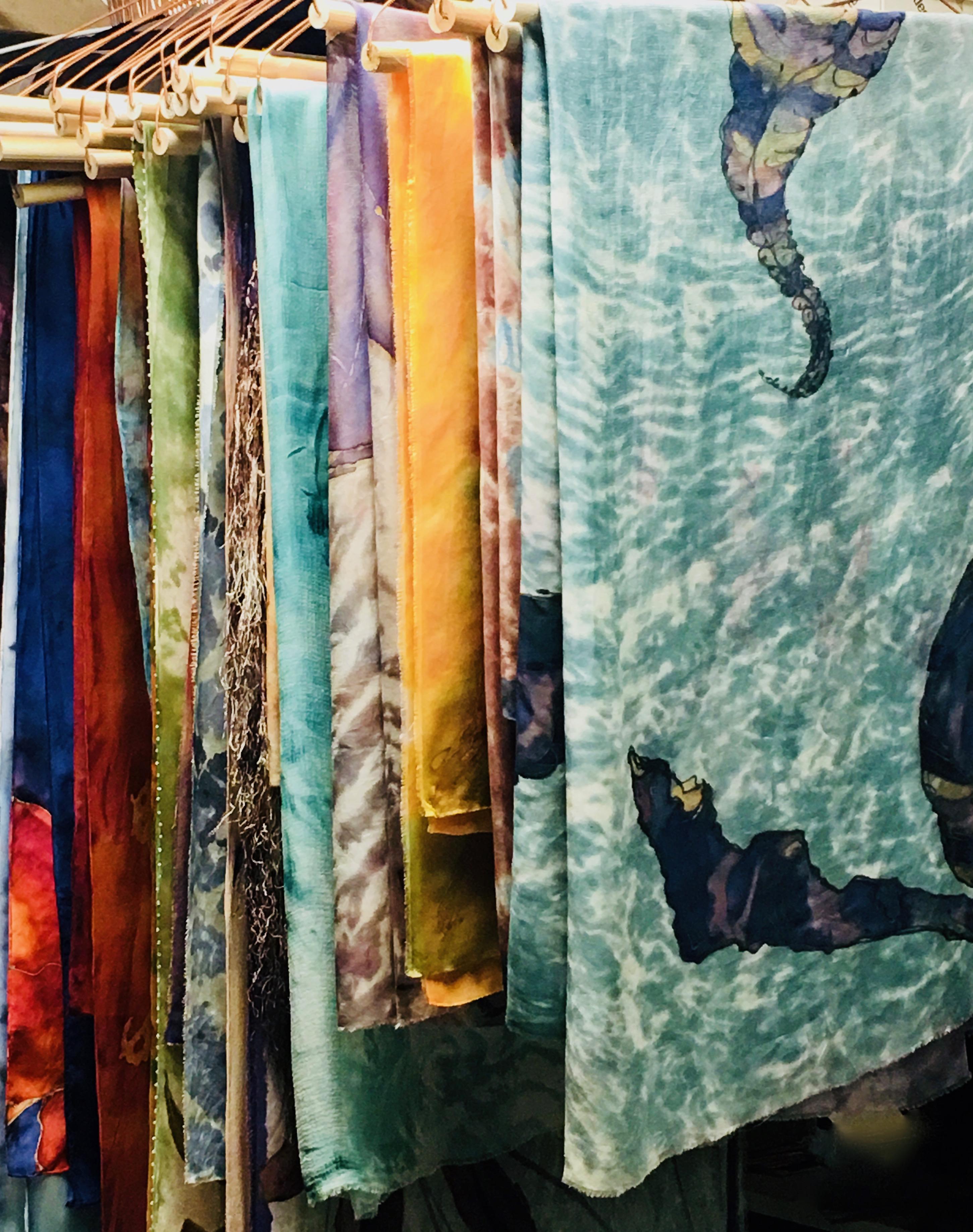 scarves on hangers in studio