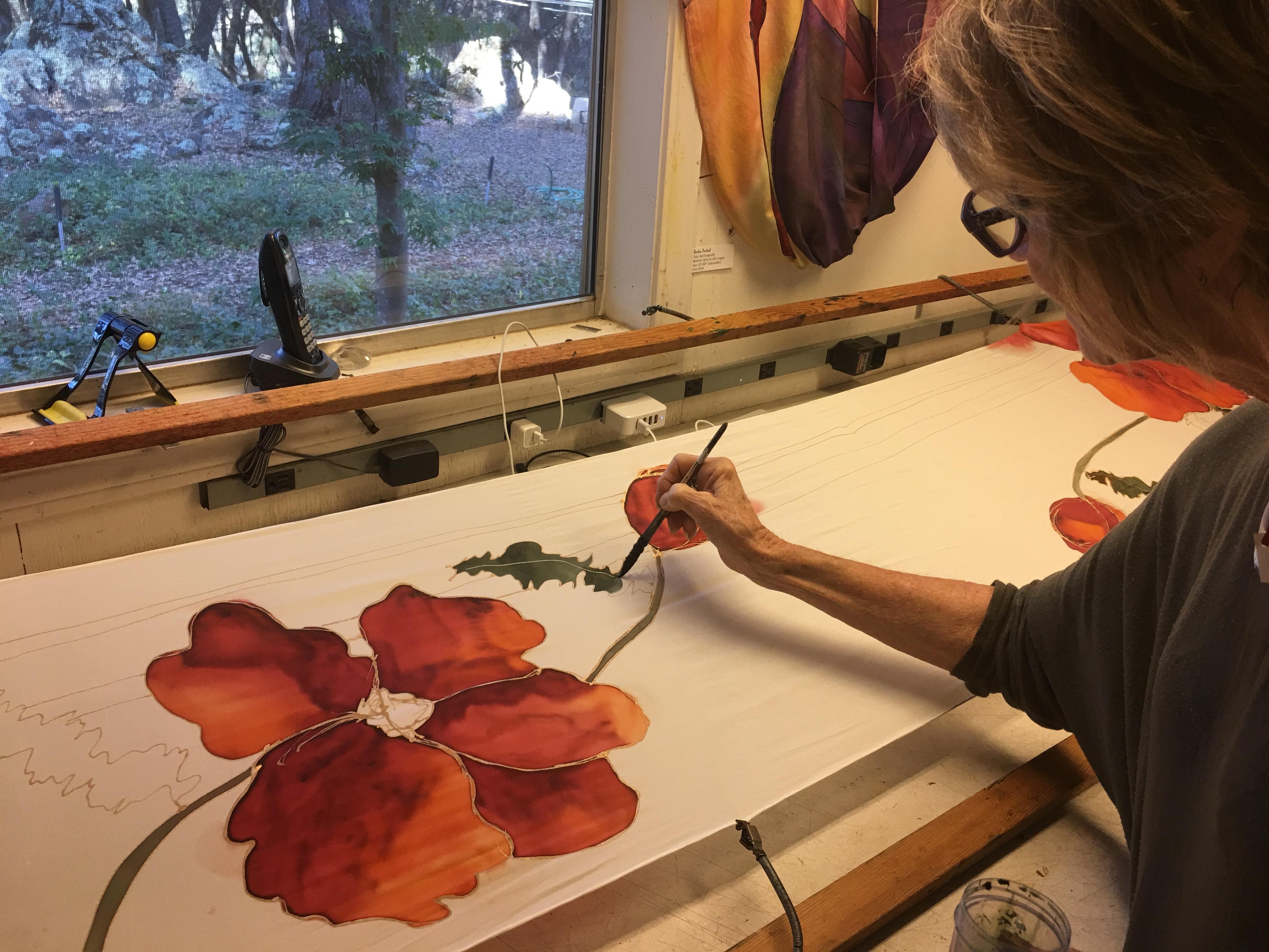 Barbra painting in studio