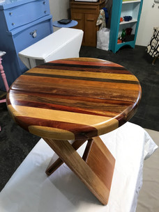 Folding stool in tropical wood