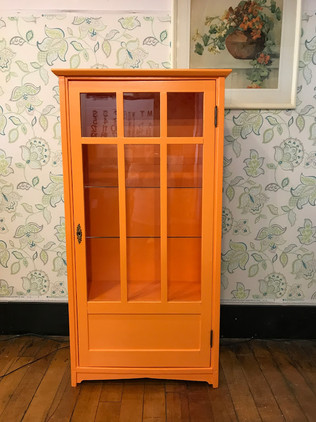 Antique glass-fronted bookcase in Carrot Stick