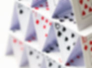 house-of-playing-cards-over-white-backgr
