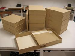 série de boites et reliures