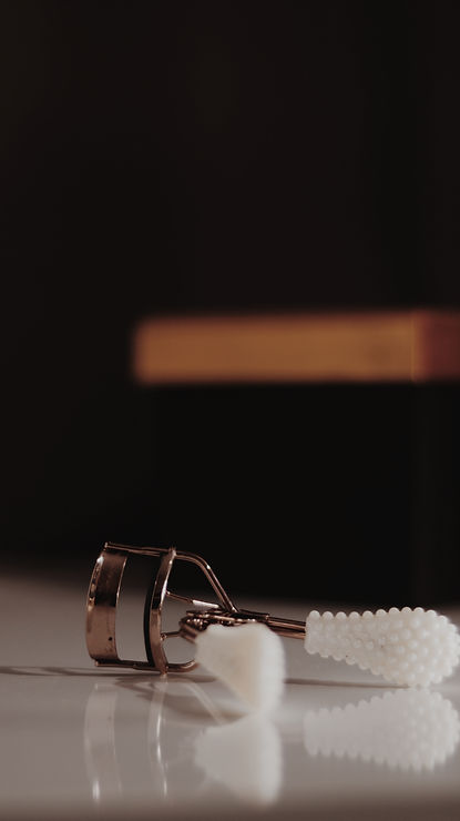 Canva - White And Silver Eyelash Curler.