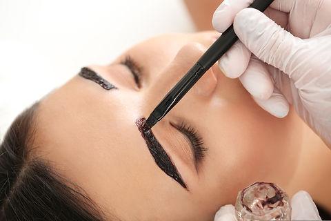 Young woman undergoing eyebrow correctio