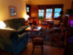 Picture of Arlyn's group room with chairs and sofa in a circle
