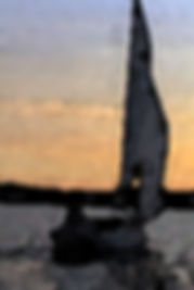 Digitized picture of Arlyn sailing her boat with sunset sky