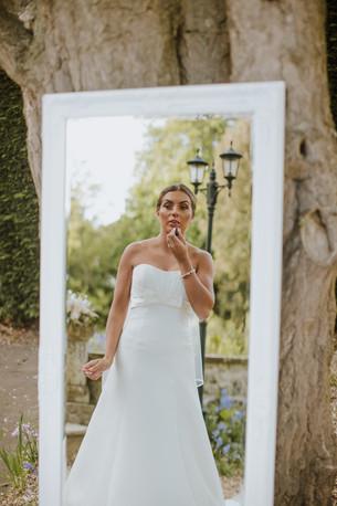 Long white bevelled mirror