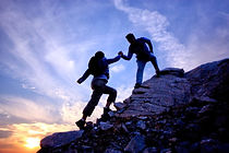 climbing-up-mountain-with-helping-hand.j