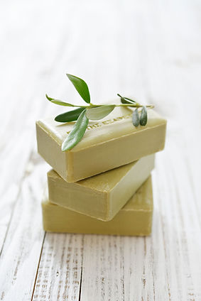 Organic soaps stack of three with rosemary leaf on the top
