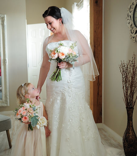 Precious moment between bride and flower girl.