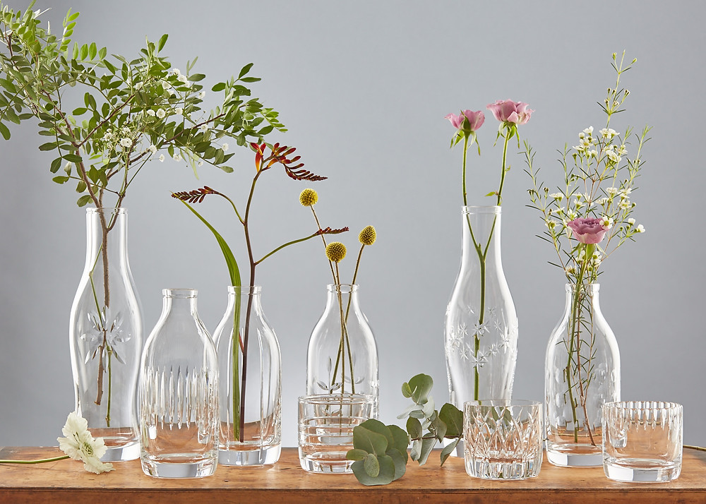 Mixed group of handblown 24 % lead crystal bottles