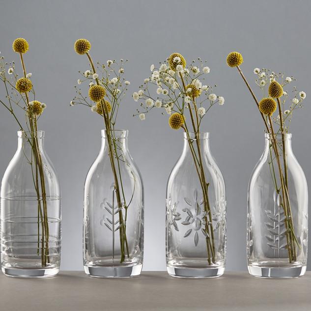 Cut glass milk bottles by Samantha Sweet