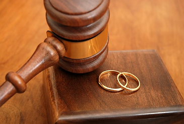 judges gavel and wedding rings