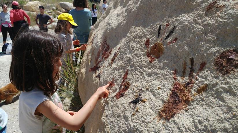 kids painting on stone beltane.jpg
