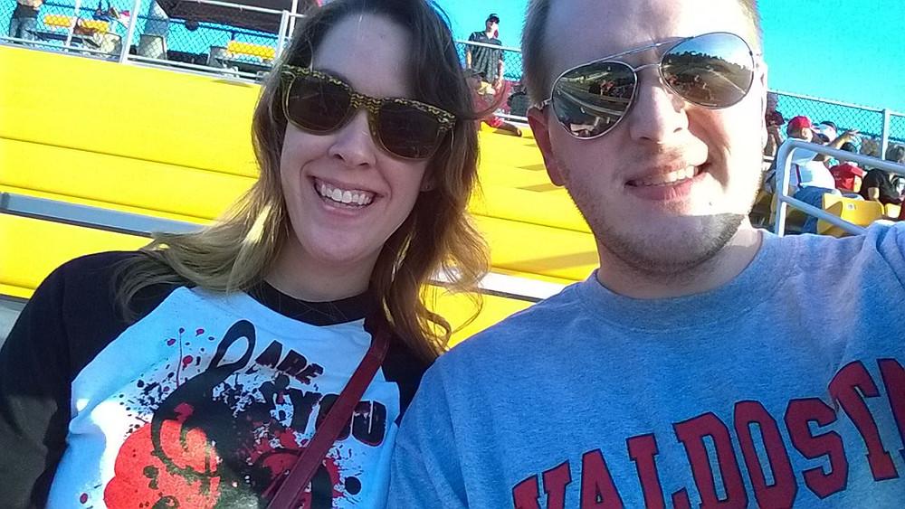 Mrs. & Dr. Rowland enjoy a Blazer football game