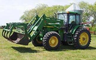2000 John Deere 7410 Tractor FWA & FEL w/ Two Buckets & Grapple
