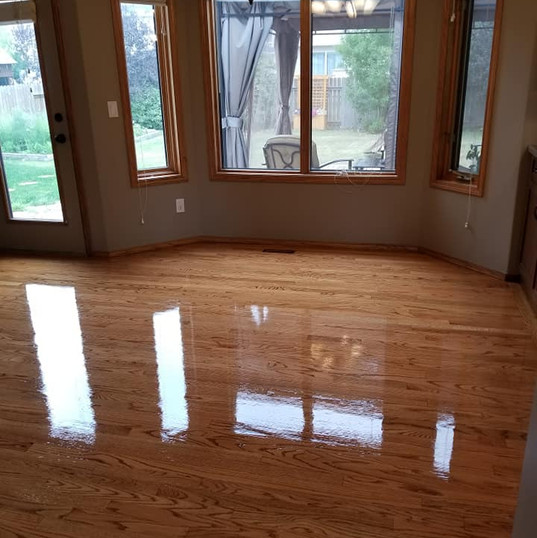 We stained this floor a golden oak to match existing wood work in the house , the finish was just applied and this gives you a idea of what a high gloss finish would look like.