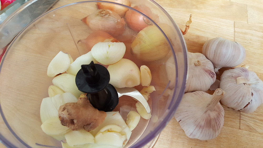 onions, garlic and ginger into chopper