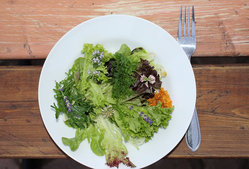 Organic salad with wild flowers