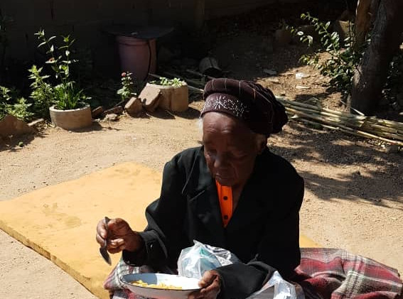 Grace Tshuma receiving her pads