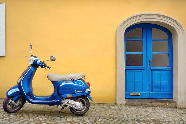 blue vespa yellow door.jpg